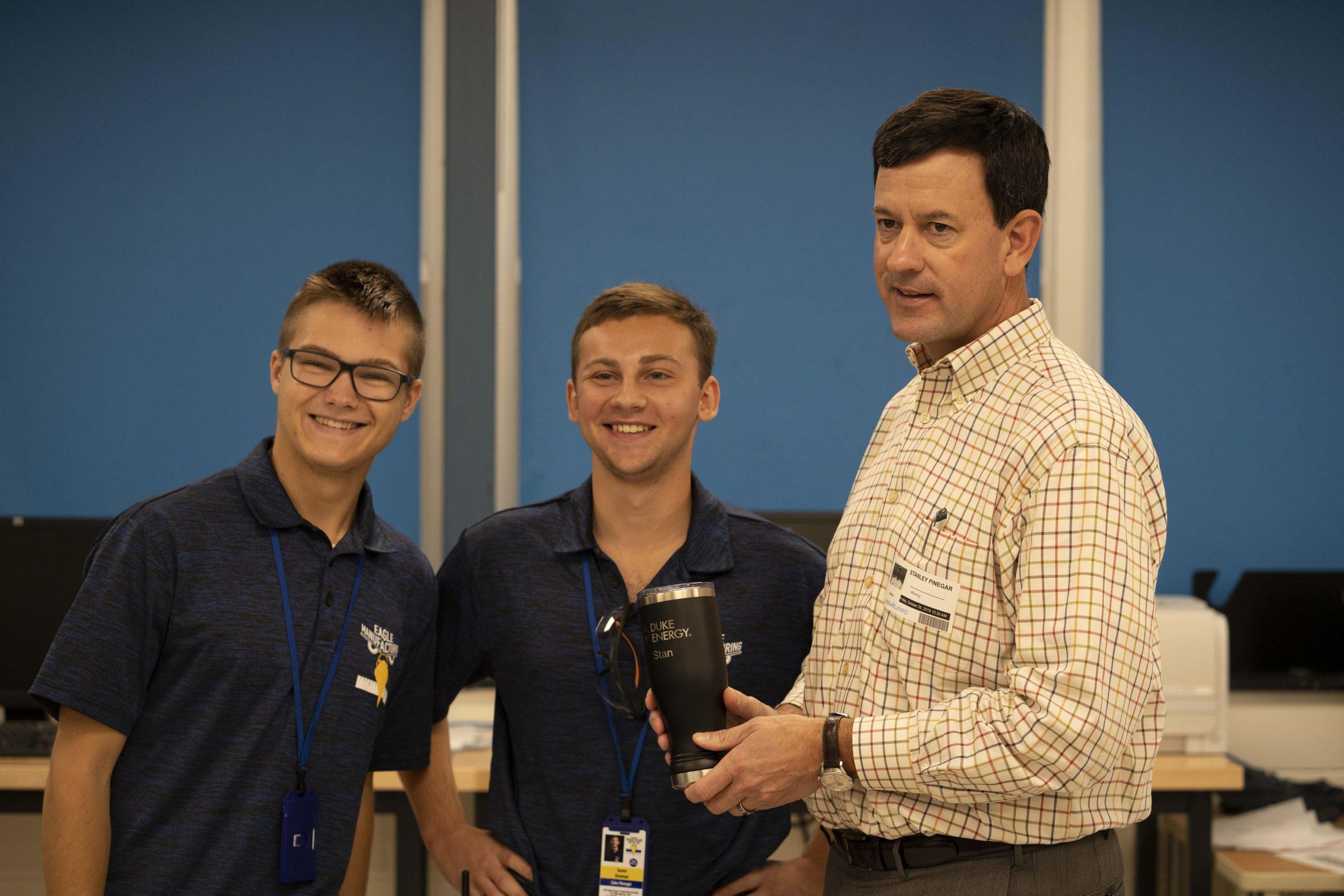 President of Duke Energy's Indiana Operations, Stan Pinegar, receives his custom Duke Energy tumbler